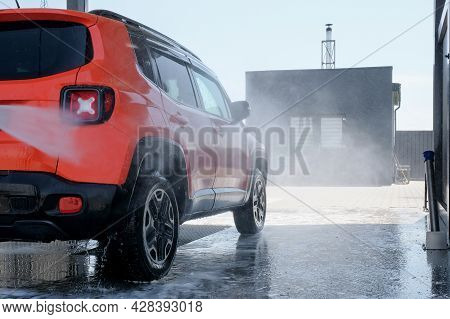 Manual Car Wash With High Pressure Water In The Open Air. Car At A Car Wash Close-up
