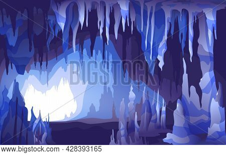 Interior View Of Cave Entrance With Spectacular Stalactites And Stalagmites Formations In Blue Grey