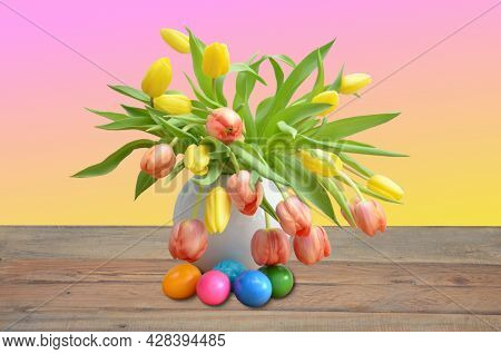 A Bouquet Of Tulips In A White Vase And Easter Eggs