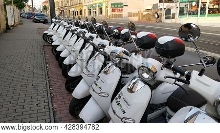 Prague, Czech Republic - June 23, 2021: Sharing Motorbike Company Fleet Line Up By The Road Waiting