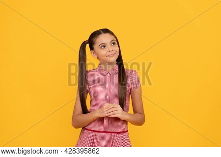 Dreamful School Age Girl Child With Pensive Look Fantasize About Something Yellow Background, Dreame