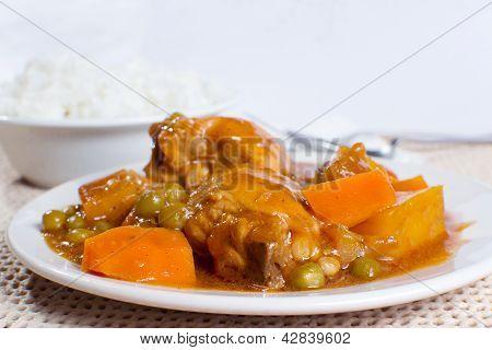 Chicken Afritada With Bowl Of Rice Closeup