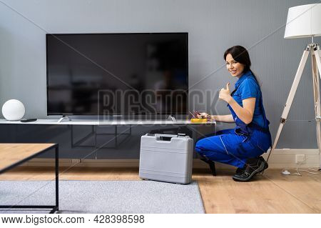 Electrician Repairing Television Or Tv Appliance. Fixing Screen