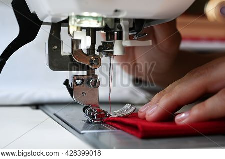 A Female Hand Is Sewing. Hobby Concept. Handmade Clothes. Making And Reparing Clothes