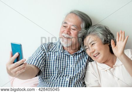 Senior Couple Using A Smart Phone Take A Picture By Yourself , Couple Photo Shoot , Smiling Feel Hap
