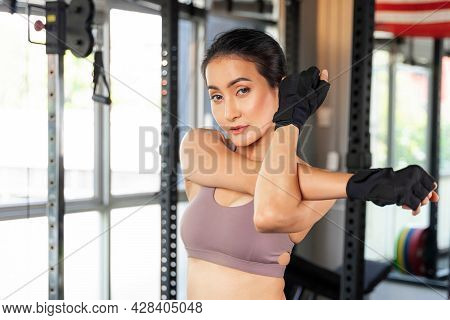 Beautiful Fitness Slim Fit Woman In Sportswear Stretching Her Arm  In A Gym Room , Asian Sexy Girl S