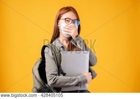 Portrait Of A Beautiful Young Woman Student Wearing Protective Face Mask For Protection Coronavirus