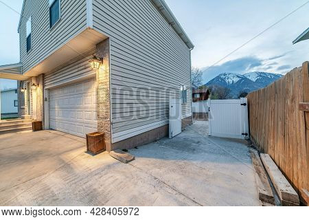 Side View Of A Two Storey House With Vinyl Wood Siding And A View Of Mountain On The Side
