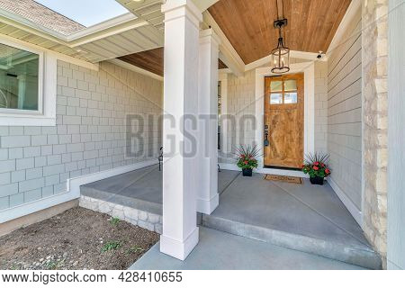 Front Porch Exterior Of A House With Decorated Concrete Block Siding