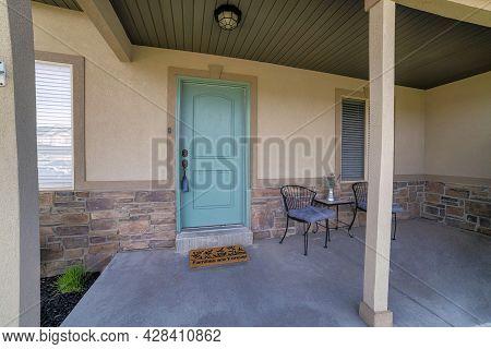 Front Porch Exterior With Mint Green Door And Decorative Doormat