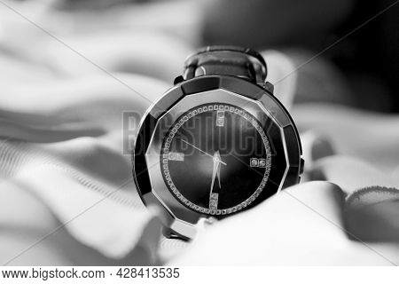 Expensive Chic Wristwatches On Fabric, Black And White Photo