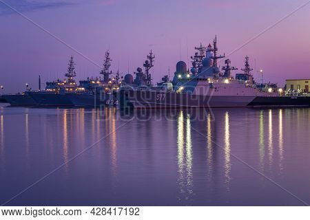 Kronstadt, Russia - July 27, 2019: Warships Of The Baltic Fleet In Middle Harbor On July Twilight