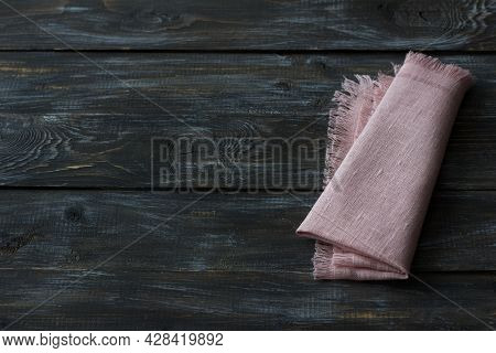 Pink Linen Napkin With Fringe On A Wooden Background, Rustic Style, Top View, Space