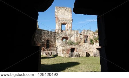 Ruin Of Boskovice Castle In The Czech Republic. View Of The Remains Of The Battlements Through The G