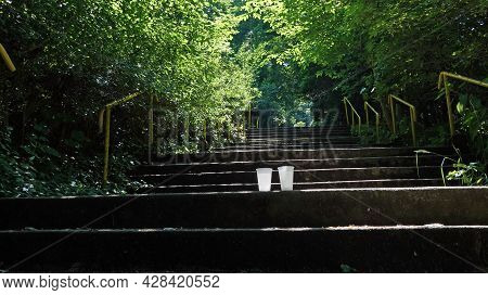 Two Plastic Cups Filled With Mineral Water On The Spa Stairs In Teplice Nad Becvou