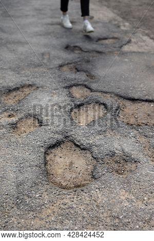 Broken Pavement, Potholes In The Asphalt, Large And Deep Holes Or Potholes