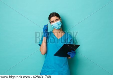 Covid-19, Pandemic And Medicine Concept. Close-up Of Puzzled Female Doctor In Medical Mask, Gloves A
