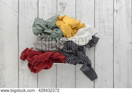 A Bunch Of Colorful Clothes On The Floor, A Mess Of Clothes, Organizing The Storage Of Things At Hom