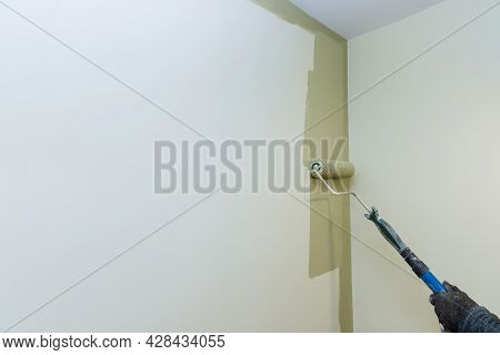 Painting Apartment, Renovating With Color Paint Roller Brush Works Painting The Surface Wall.