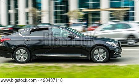 Moscow, Russia - May 2021: Black Color Genesis G80 First Generation In Fast Motion On The Street