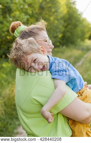 A Mother Gently Hugs A Disabled Child. Infantile Cerebral Palsy. Enabling. Disability. A Family With