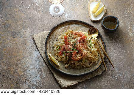 Tagliatelle Pasta With Huge Prawn In Cream Sauce, Dark Photo