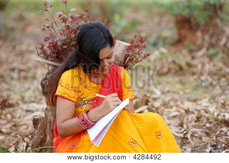 Rural Woman Learning To Read And Write