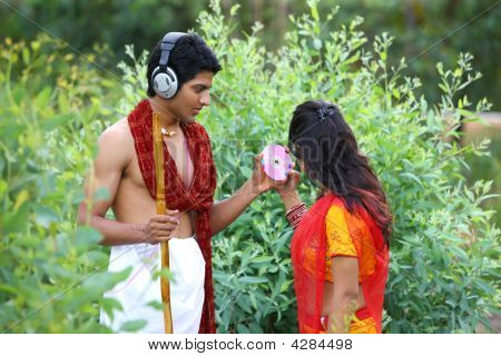 Asian Rural Couple With Headphones