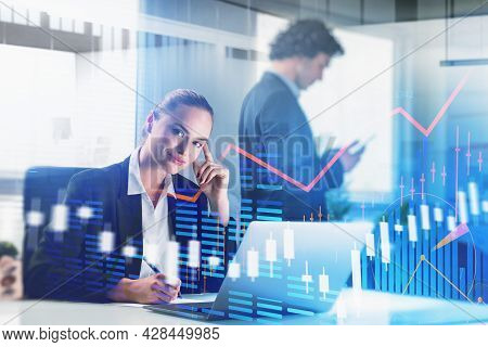 Smiling Attractive Businesswoman Is Taking Notes On Workplace And Walking Businessman On Background