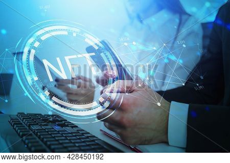 Businessman And Businesswoman Browse The Internet Using Digital Devices, Non-fungible Token Hologram