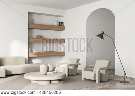 Living Room With Archway And Three Shelves In The Niche. Interior In Light Shades Of Beige With Sofa