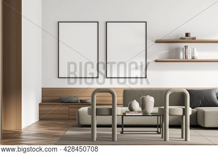 Two Framed Banners In The Living Room Interior With Beige Sofa, Two Stools, Minimalist Coffee Table,