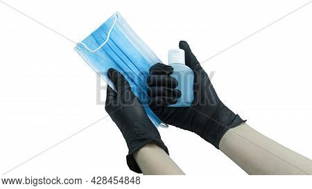 Female Hands In Medical Gloves Holding Protective Face Mask Isolated On White. Coronavirus Protectio