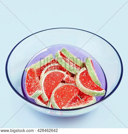 Jelly Candies. Close-up Of Watermelon Jelly Candies In A Transparent Bowl On A Light Blue Background
