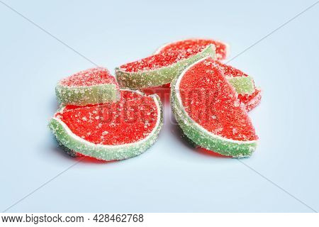 Jelly Candies. Close-up Of Jelly Candies Sprinkled With Sugar On A Blue Background. Watermelon Marma