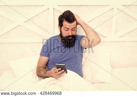 Mobile Life Through Phone. Bearded Man Use Mobile Phone In Bed. Hipster Check Mobile Notifications I