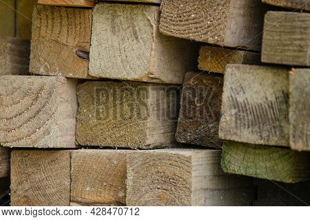 Stacks Of Planks Of Timber Hard Wood Stacked On Top Of Each Other.
