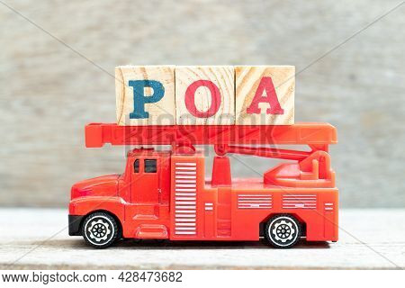 Fire Ladder Truck Hold Letter Block In Word Poa (abbreviation Of Plan Of Action, Power Of Attorney,