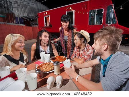 Hipsters With Plates Of Pizza