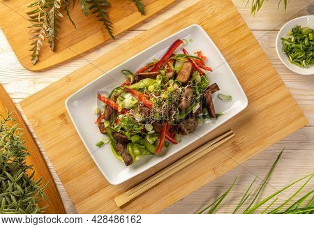 Flat Lay Of Asian Style Salad With Beef Cubes Decorated With Sprouts