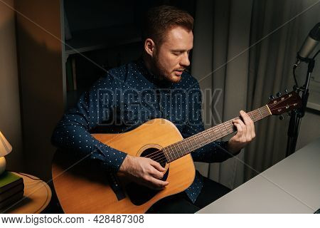 Talaented Guitarist Singer Man Emotionally Singing Into Condenser Microphone And Playing Acoustic Gu