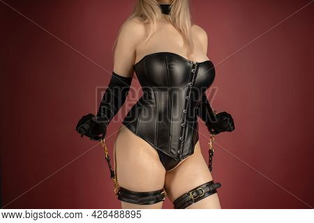 Beautiful Young Woman In A Leather Corset And Bondage Set Posing