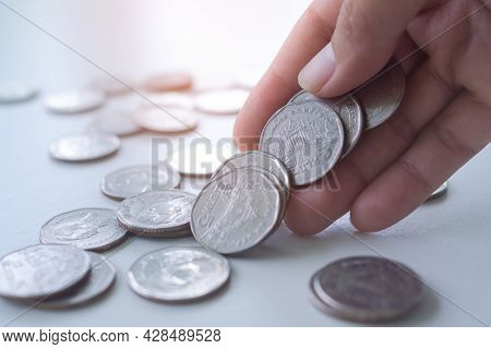 Hand Woman Holding Thai Coin With Over And Light Day. Planing Earn Investment And Saving Money Futur