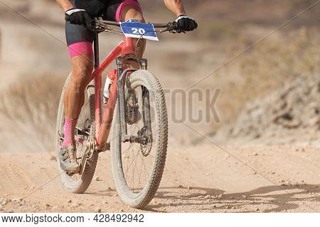 Mountain Biker Riding On Bike Singletrack Trail, Front View Of Mountain Biker. Mountain Bike Race