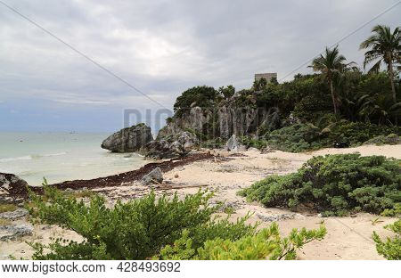 View Of The Coast And The Tower Of The Castillo In Tulum, Mexico. High Quality Photo