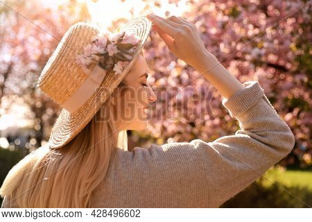 Young Woman Wearing Stylish Outfit In Park On Spring Day. Fashionable Look