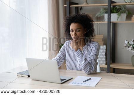Pensive African American Woman Work On Laptop Online