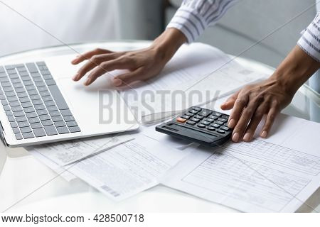 Close Up Of Ethnic Woman Calculate Expenses Manage Budget