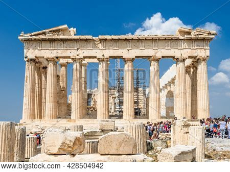 Athens - May 8, 2018: People Visit Parthenon On Acropolis On Sunny Day, Athens, Greece. It Is Top To