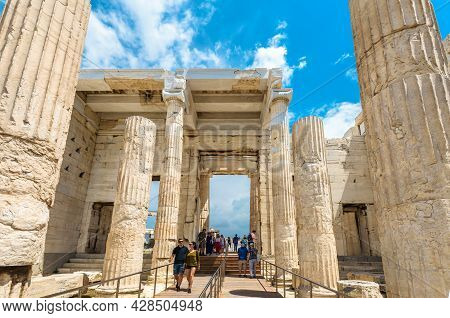 Athens - May 8, 2018: People Visit Ancient Greek Propylaea On Famous Acropolis Of Athens, Greece. Ac